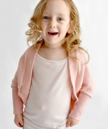 This childrens cocoon cardigan sewing pattern makes a slouchy, comfortable cardi and comes in three sleeve options. Perfect for beginner sewistas!