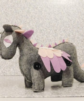 Prehistoric adventures and magical quests await with this adorable handsewn dino toy! Makes just about any creative creature your heart desires!
