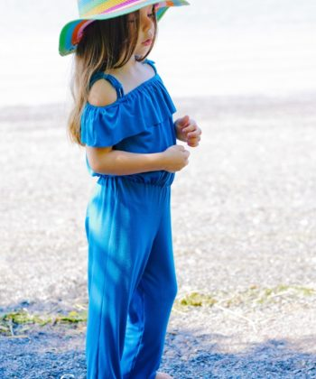 Jill, a cute and summery childrens off the shoulder jumpsuit sewing pattern in sizes newborn to 12 years with a frilled shoulder flounce for extra interest!
