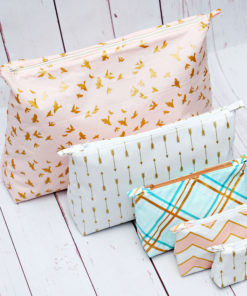 The Zoe is a beautifully-finished and fully lined zip pouch sewing pattern that has FIVE different sizes to suit your needs AND bust your scraps!