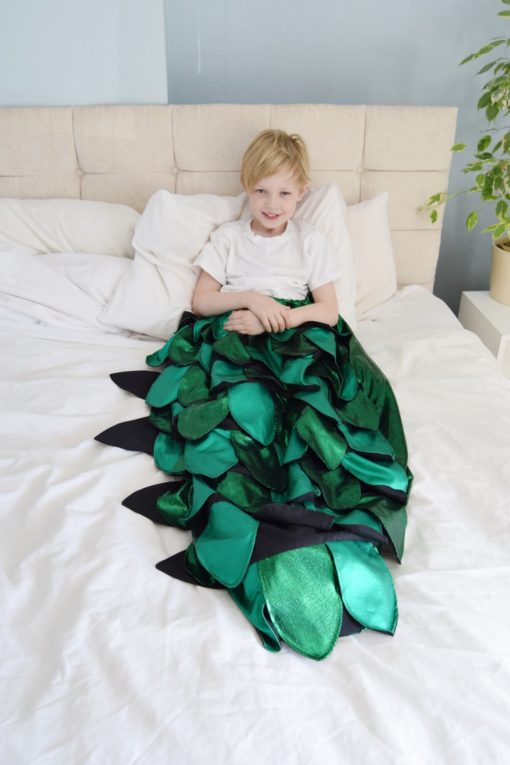 Add some snuggly magic to your life with this whimsical dinosaur blanket sewing pattern. Magic blanket tails for everyone, including the dolls.