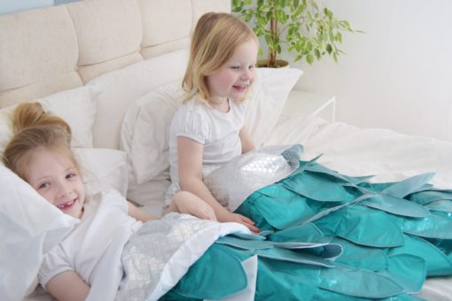 Add some snuggly magic to your life with this whimsical mermaid blanket sewing pattern. Magic blanket tails for everyone, including the dolls.