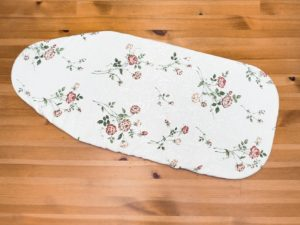 Customize your sewing room with this DIY ironing board cover tutorial! It's quick and easy to give your sewing space an bit of magic with this pattern.