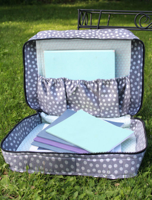 Sew a mini vintage-style suitcase with this incredibly versatile carry case sewing pattern. Use your scraps and other fun trims for a cute case.