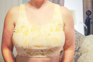 From crop top to workout top, with an optional phone pocket, this ladies tank top sewing pattern takes you where you need to go.