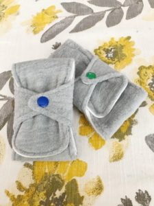 Turn your scraps into something healthy, affordable, and eco-friendly with this reusable pads sewing pattern. Plus individual and large wet bag patterns!