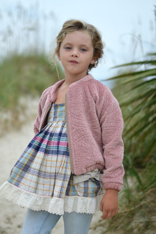 Sew up some warm, sporty casual style with this childrens bomber jacket sewing pattern in sizes 12 months to 12 years.