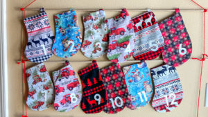 Countdown to Christmas with this beautiful sew! The Stocking Advent Calendar sewing pattern will become a treasured family heirloom.
