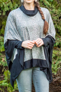Keep warm with this quick and easy sew. This gorgeous Sweater Cape is a women's poncho sewing pattern in sizes XXS to 5XL.