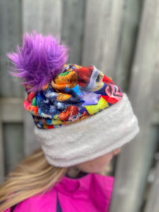 This quick and cozy sew with a fun pom pom detail will keep your head and ears warm all winter long! The beanie sewing pattern comes in sizes 13 to 24-inch head circumference and will fit everyone!