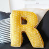 26 letters, 10 numbers, 2 sizes, and various finishing options… the Alphabet Pillows sewing pattern gives you everything you need to personalize your décor to the letter.