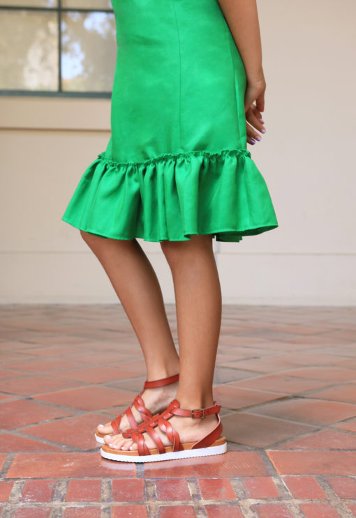 Swing into summer with a stylish silhouette! The children's Tie Shoulder Tiered Dress is a breezy summer dress that comes in sizes12 months to 12 years.