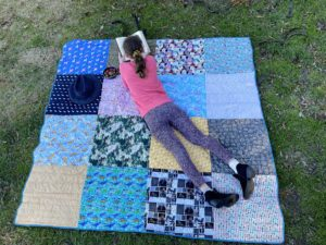 Explore the outdoors and picnic in style with this picnic blanket sewing pattern. Make a reversible, quilted blanket that rolls up neatly for your next adventure.