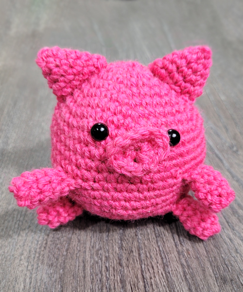 Create the perfect playtime pal with this sweet crochet roly polly piggy pattern. A lovely cuddle buddy, farmyard addition, or decor item, the Roly Polly Piggy is a cute stuffed toy with a friendly face